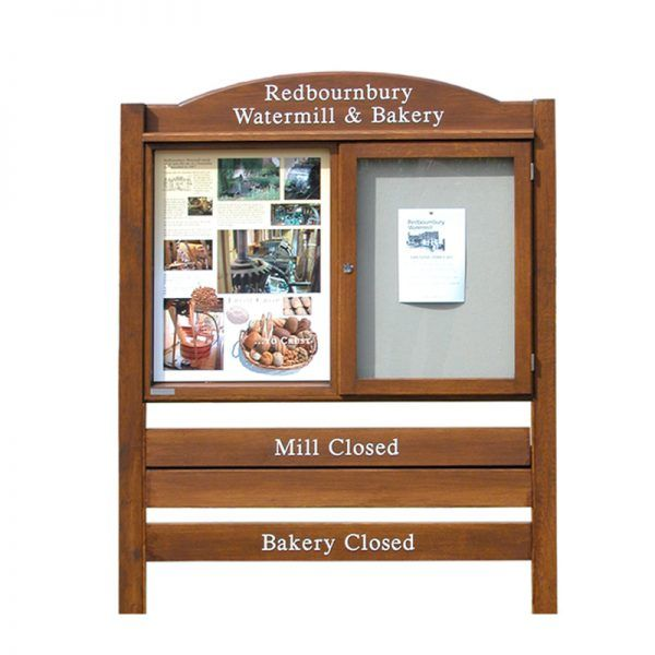 "2-bay, 4 x A4 oak noticeboard, 1 bay glazed, with bespoke sign ""planks"", Redbournbury Mill & Bakery"