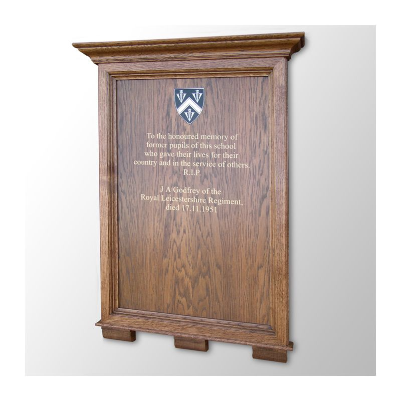 Memorial honours board with corbels and cornice in dark-stained solid oak.
