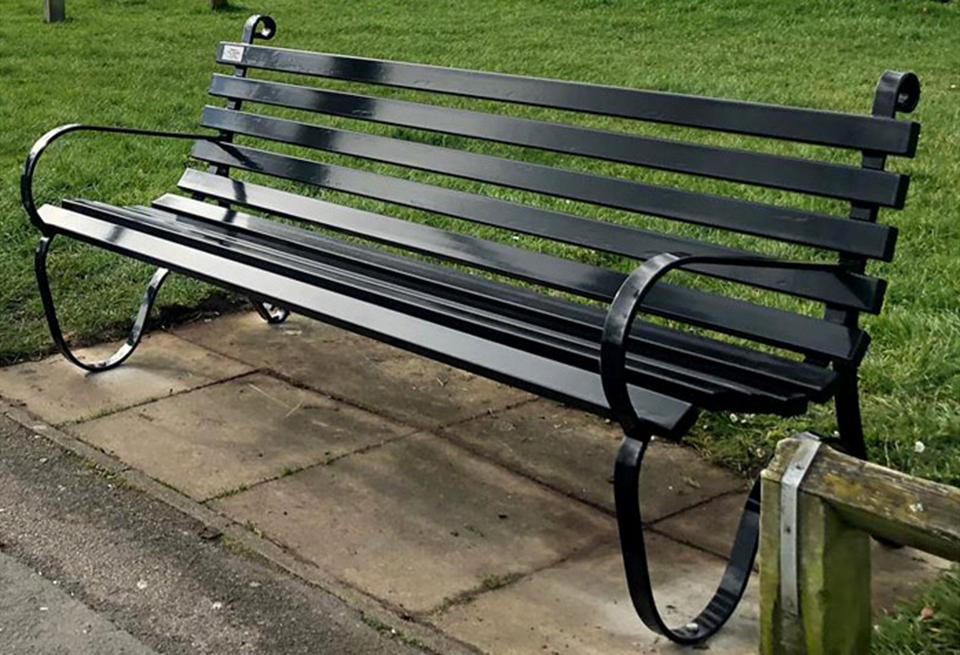 Ornate, powder-coated steel park bench