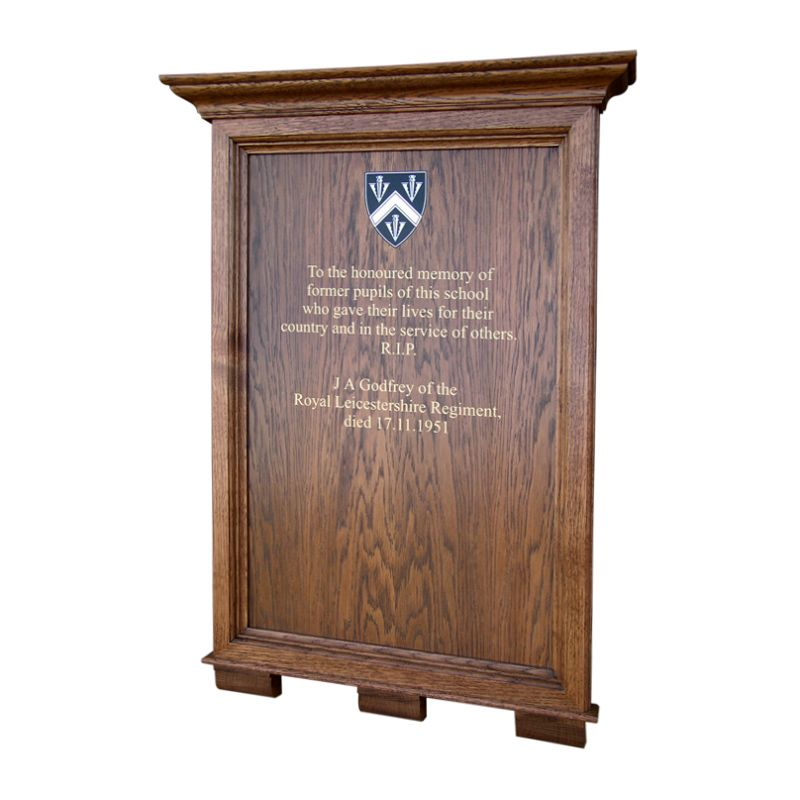 Honours boards for schools: Chapel memorial board for Bloxham School in oak with moulded cornice and corbels